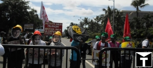 Anti-mining protestors rallying at the gates of Sofitel Plaza