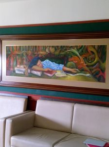 A painting commissioned by the Dean which is hung in the student library features a young student taking a nap midst a number of books. I found it funny. Any idea why? ;-)