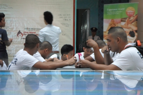 A photo cadets signing their application for blood donation