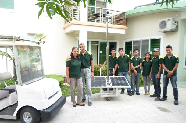 Husband & Wife duo, Rod & Lyn, together with their team welcome us into their impressive solar powered home and office. Here the couple pose with solar panels and solar powered golf cart.