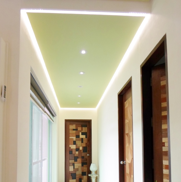A view of a hallway leading to guest rooms is well lit with solar powered lights. The transition to LED lights has significantly lowered their energy consumption by 30-40%.