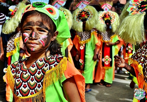 A Filipino child joining the Ati-Atihan festival celebrated only in the Philippines.