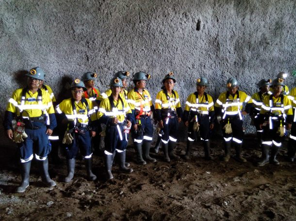 Safety first. Filipino miners dressed for work.